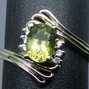 14kt peridot and diamonds ring; FREE SIZING