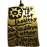 """SALE ICONIC """"War is Not Healthy for Children & Other Living Things"""" Pendant 1968"""
