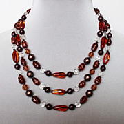 Brown burgundy vintage necklace of Murano glass beads crystals and plastic beads.