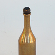 REDUCED Small brass bottle Trench art gambling device