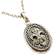 Pretty sterling silver locket with marcasite fleur de lis on sterling chain