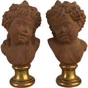 """Superb Vintage French Terracotta Putti Busts on Gold Gilt Bases in the Theme of Bacchantes Signed """"Clodion"""" to lower verso. C. 1940 – 1960"""