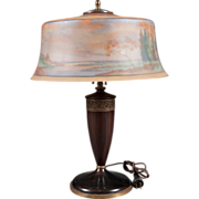 A Reverse Painted American Pairpoint Landscape Lamp with Carved Wooden Base.