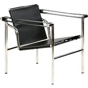 Chrome and Leather LC1 Basculant Style Arm Chair, after Le Corbusier