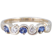 Curvaceous Sapphire, Diamond And Gold Wedding Band