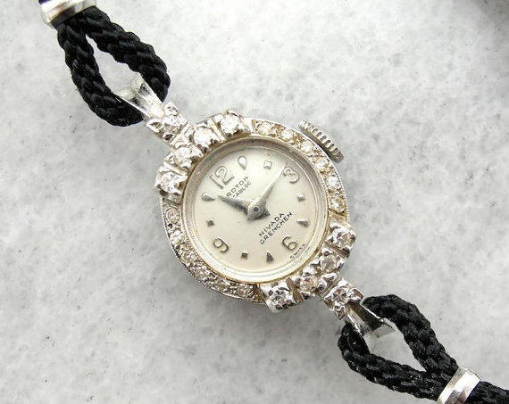 vintage wrist by croton in 14k white gold