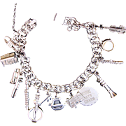 Vintage Silver Charm Bracelet with Musical Instrument Charms