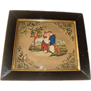 Needlepoint picture of couple with dog 19th century