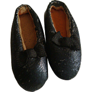 Pair of old oil skin dolls shoes