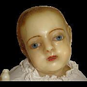 Wax baby creche figure