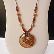 """REDUCED Textured Wood Pendant Golden Horn and Carved Bone Beads on Brown Leather 29"""" Long"""