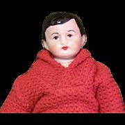 Cute bisque boy doll in a Mattel's Ken sweater