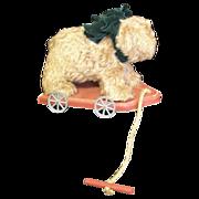 Teddy bear on a wheeled platform