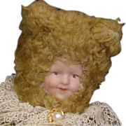 Vintage Teddy with a bisque face