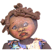 Black doll with a wonderful painted face