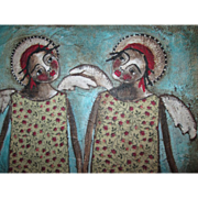 Angel painting two primitive Black sisters