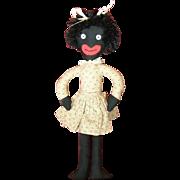Cute whimsical black doll.