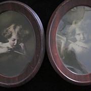 Cupid Awake, Cupid Asleep Sepia Tone Prints in Oval Metal Frames