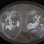 Cupid Awake/Cupid Asleep in Oval Frame with Heart Mat