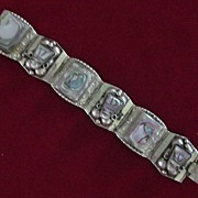 Taxco Sterling Silver Mother of Pearl Aztec Mask Bracelet