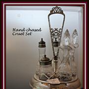 Cruet stand:  Rotating 5 bottle holder w/etched floral designs