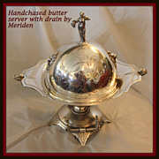 Butter dish in Victorian quadruple plate with drain plate hand chased by Meriden