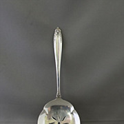 Prelude tomato server in solid sterling by the International Silver Co.