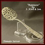 Repousse tomato server by S. Kirk & Son w/fancy piercings