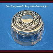 Repousse dresser jar in sterling and cut glass