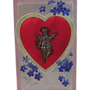 Vintage Valentine Postcard with Metal Cupid on it