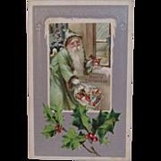 SOLD 1907 Green Robe Santa Embossed Christmas Postcard