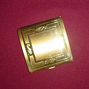 Pretty Goldtone Brass Powder Compact with Stylized Leaf Design