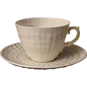 Belleek Limpet Yellow Teacup and Saucer
