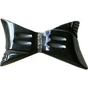 Carved Black Bakelite Bow Pin with Clear Rhinestones Center