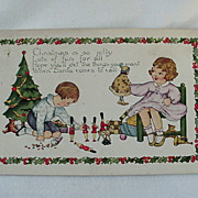 Christmas Postcard Boy Playing With Toy Soldiers And Girl Playing With Doll