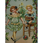 A Merry Christmas  Postcard Two Children Holly Border