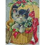 A Merry Christmas  Postcard Cat In A Basket With Holly