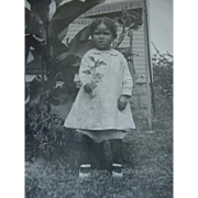 Black Americana Photograph Photo Little Girl Standing In Front Of Canna Lily With Twig In Hand