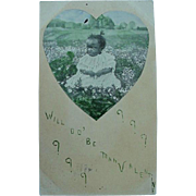 Black Americana Photo Valentine Postcard Girl Sitting In Meadow OF Flowers