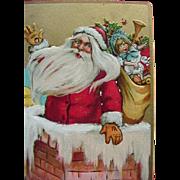 Tucks Incised Christmas Postcard Santa Waving As He Goes Down Chimney Moon Looks On