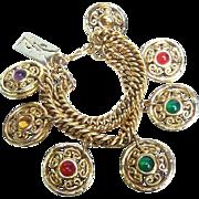 Yves Saint Laurent Gilt Medallion Charm Bracelet. 1980's.