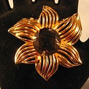 Stylized Gold-tone Flower Pin with Large Topaz Colored Center Stone