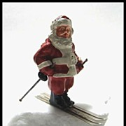 SOLD Here Comes Santa Clause on his Skis