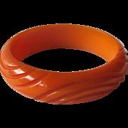 Bakelite Deeply Carved Bracelet Pumpkin or Carmel Color
