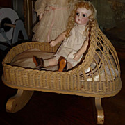 Wonderful antique wood and wicker doll cradle