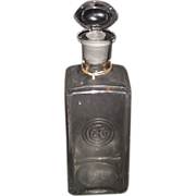 Rare Embossed Colgate Company's Logo Perfume Bottle with Ground & Polished Seeing Eye Glass Stopper.  Ca. 1910.
