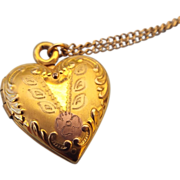 "Gold Filled Fancy Locket Hold Two Photos, Says ""I Love You"" on the back"