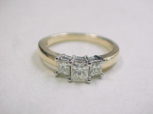 14k gold princess cut past present and future ring