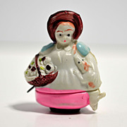 Figural Japanese celluloid tape measure – lady with dog