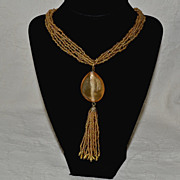 SALE Six Strand Bead Necklace with Pendant and Tassel